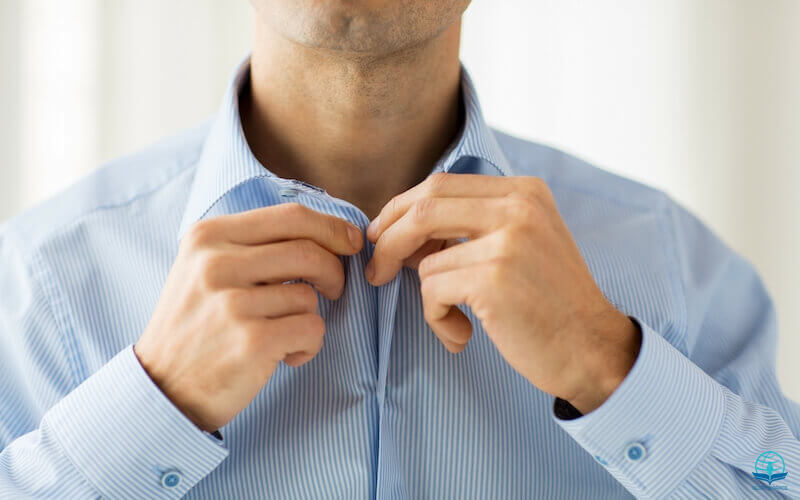 Put on the new man showing a man putting on his shirt